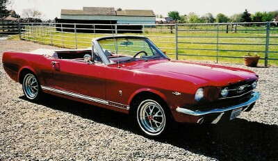 Picture red mustang convertible side view.